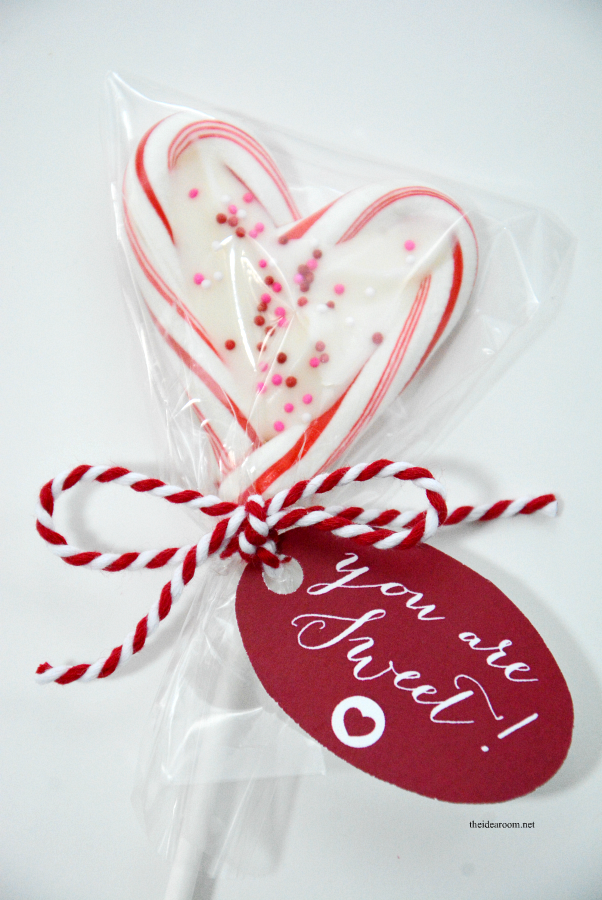 Mini Candy Cane Heart Suckers are so easy to make and are the perfect Valentine's Day treat of gift idea for friends, family and classmates.