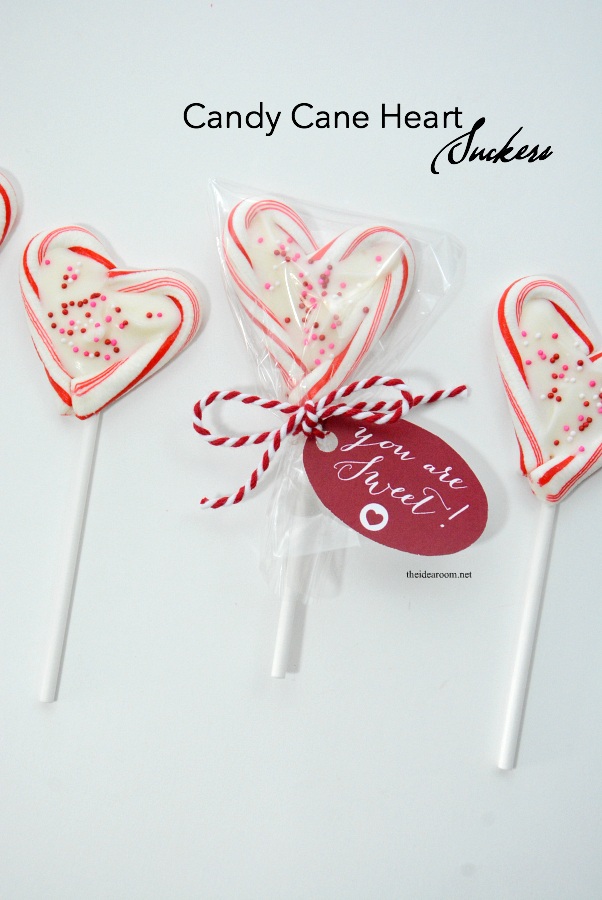 Valentine's Day | Mini Candy Cane Heart Suckers are so easy to make and are the perfect Valentine's Day treat of gift idea for friends, family and classmates.
