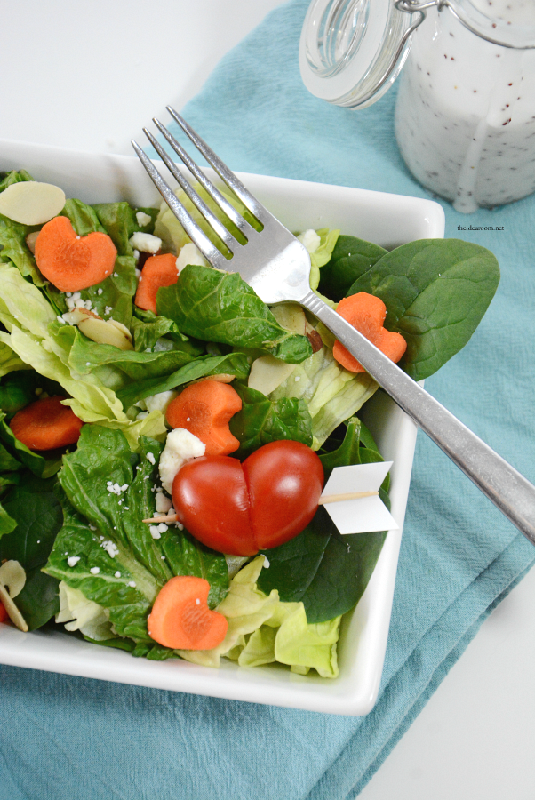 "Valentine's Day | Create and serve up this fun Valentine's Day Salad by making these ""heart shaped"" tomatoes and sliced carrots."