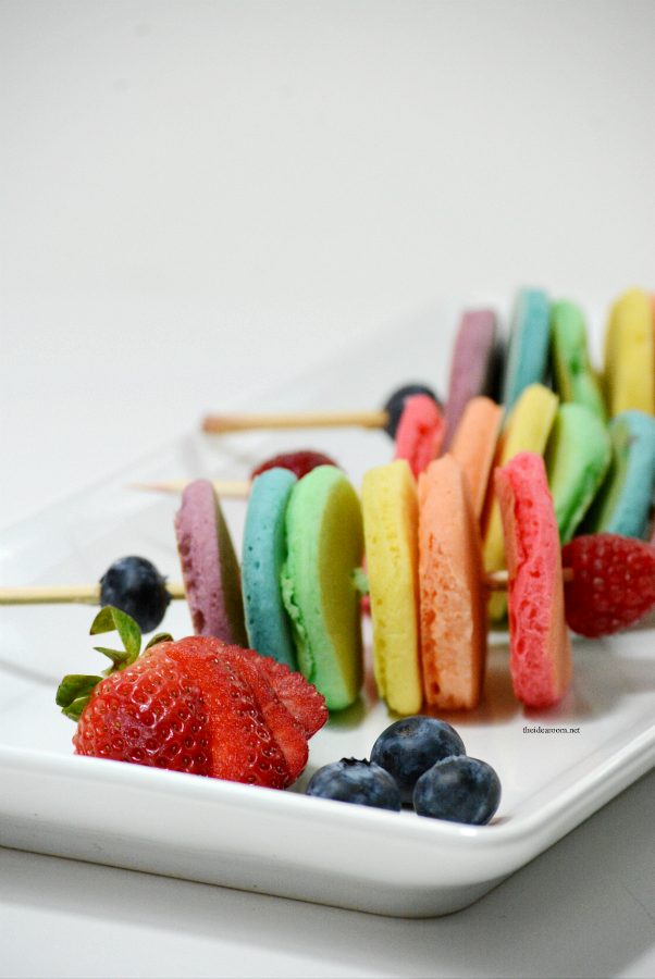 Food on a Stick | Share some happiness on St. Patrick's Day with this fun breakfast idea...Rainbow Pancakes...fun food on a stick for your family this year.