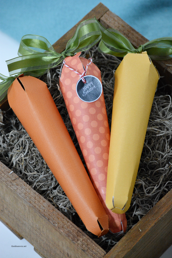 Easter | Create these Easter Paper Carrots.  Fun for an Easter Gift with your favorite Easter Treats inside or some Easter Decor.