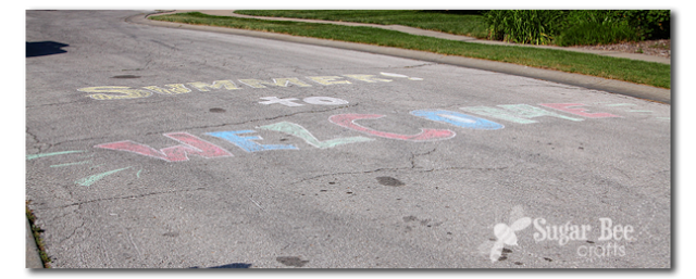 welcome to summer chalk sign on the road