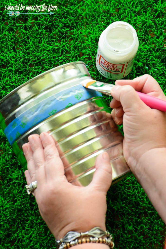 Modge Podge on tin can