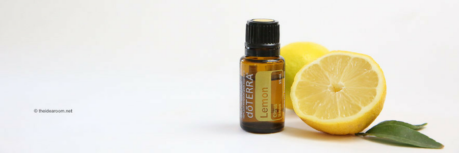lemon essential oil with lemons